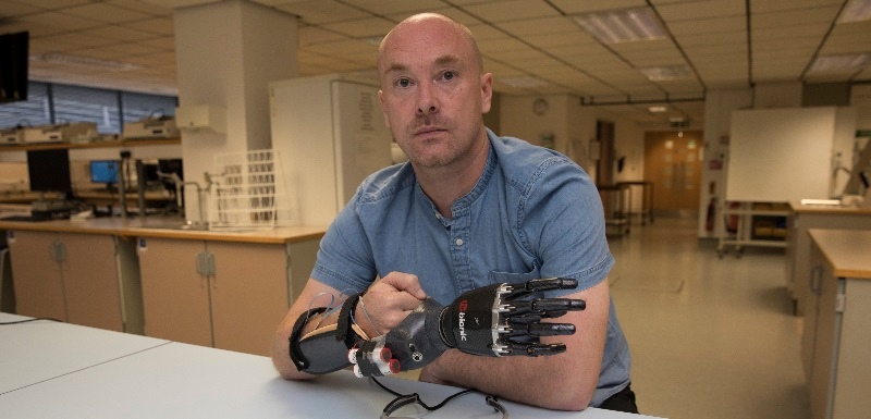Dr Greg Wood, Senior Lecturer in Motor Control and Learning, demonstrates the prosthetic hand simulator built especially for the research