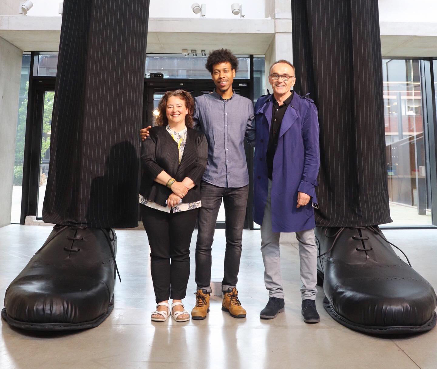 Penny Macbeth, Deputy Faculty Pro-Vice Chancellor and Dean of Manchester School of Art, with recent graduate and glassblower, Jahday Ford, and film director, Danny Boyle, at the Degree Show launch night [NO]