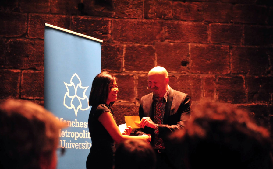 Romalyn receiving the Manchester Poetry Prize in 2017