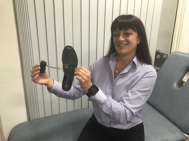 Dr Abbott displays the intelligent insole system she and colleagues tested for the first clinical trial of the technology