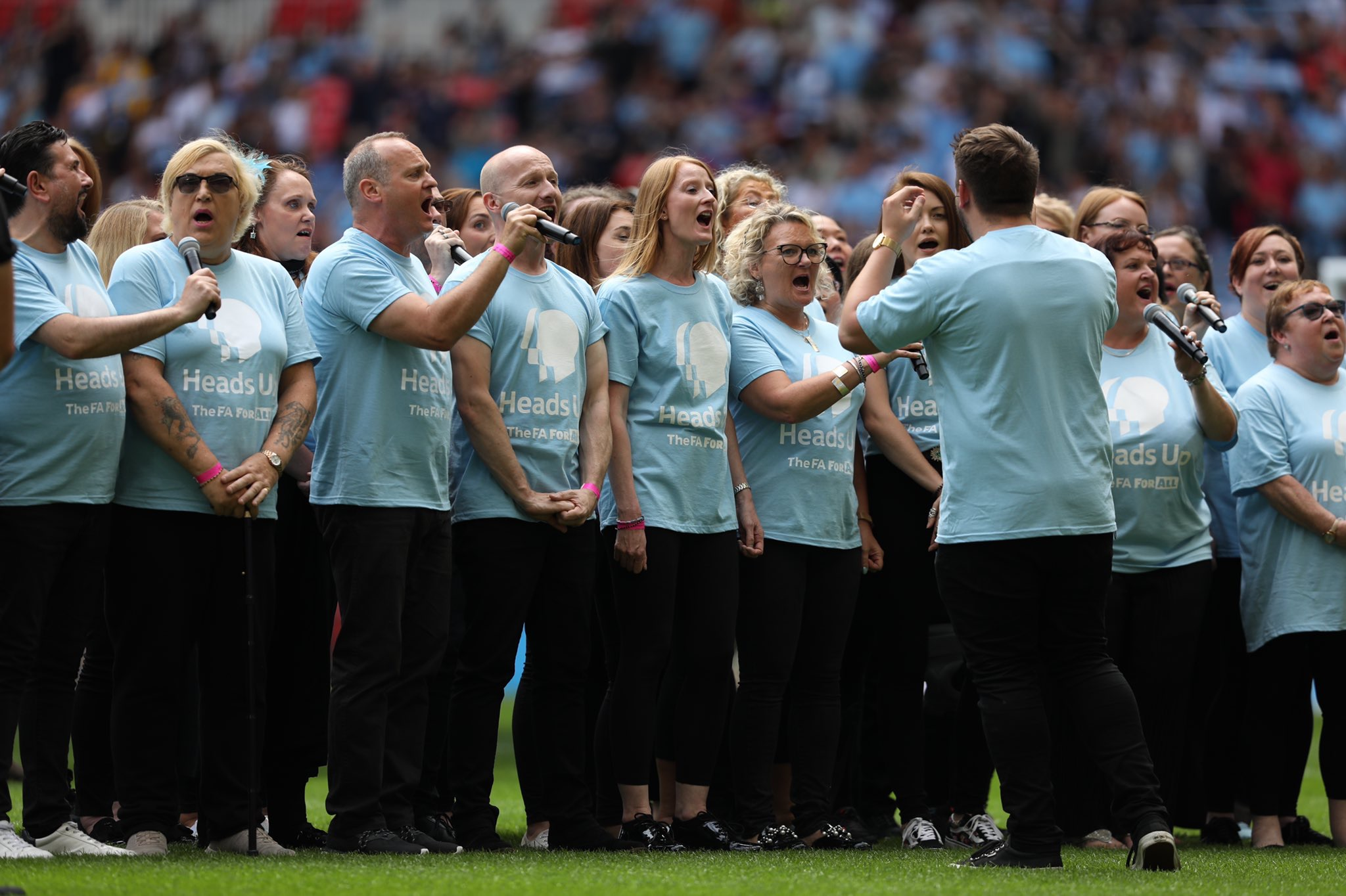 The Bee Vocal Choir, run by Manchester Metropolitan Research Assistant Elaine Craig, seen here performing at Wembley stadium