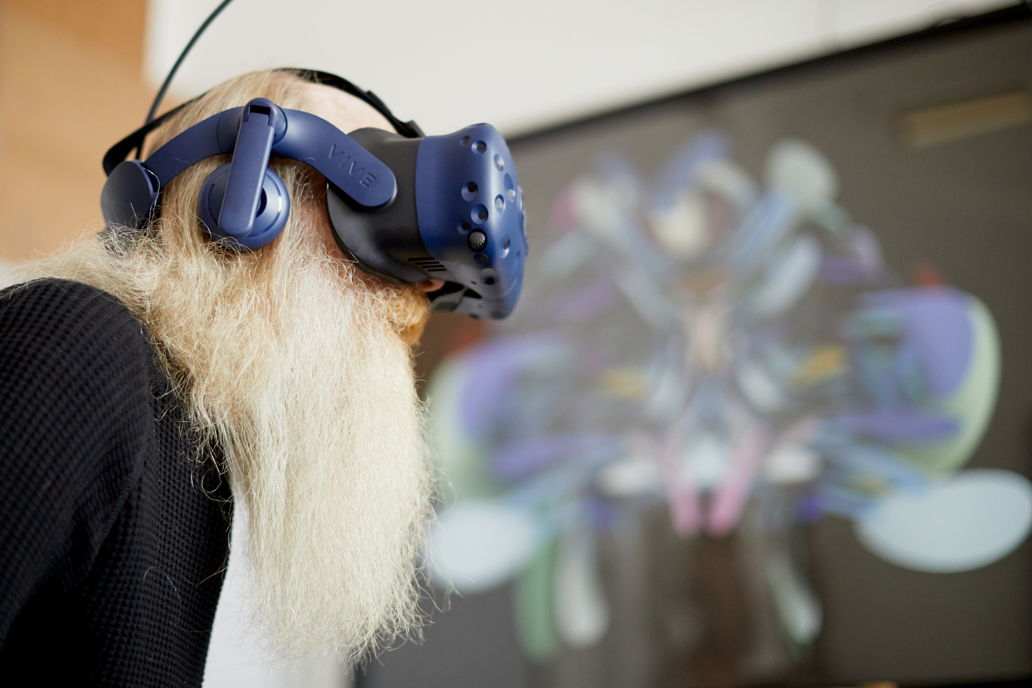 Prof Keith Brown tests out the immersive art experience