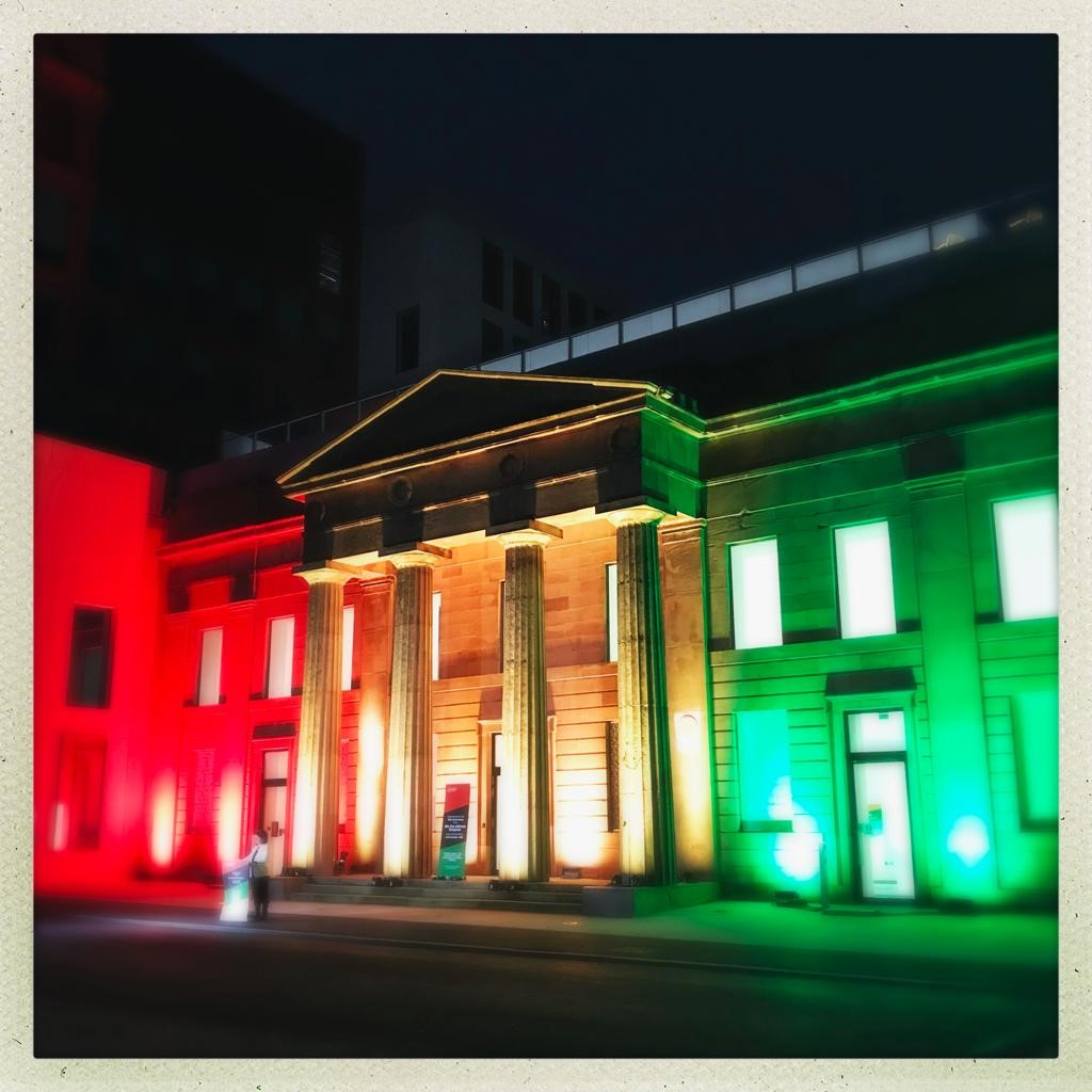 The Arts and Humanities Building lit for the celebrations of the Fifth Pan African Congress in Manchester (image: Michael Gorman, Senior Learning & Teaching Fellow at Manchester Metropolitan University)