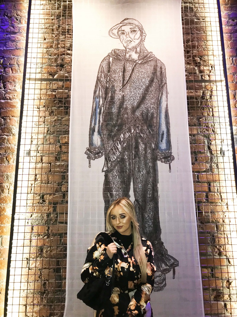 Morgan Allen, Fashion Design and Technology student, with one of her exhibited designs