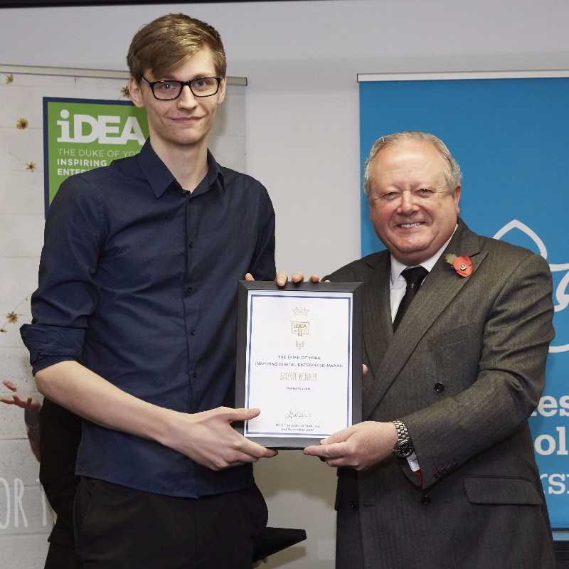 Student Daniel Wardak receives his bronze certificate