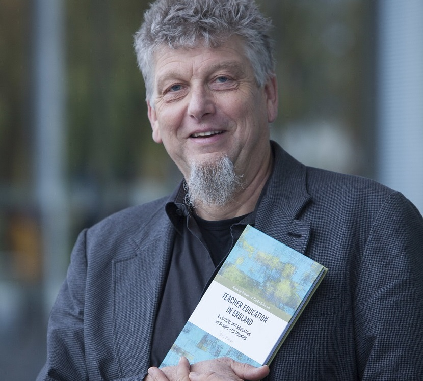 Professor Tony Brown with his new book