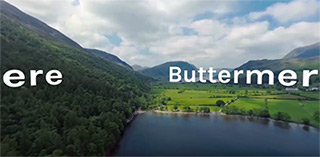 Landscape photo of Buttermere including green hills and a lake