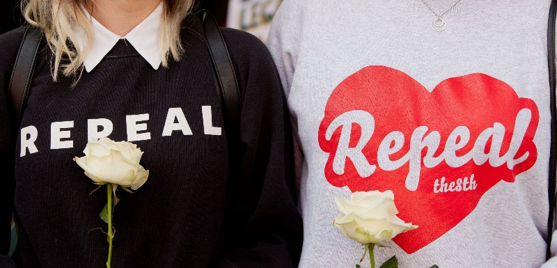 Two women wearing jumpers in support of Repeal, the Irish pro-choice movement which campaigned for the repeal of the 8th Amendment to Ireland's constitution