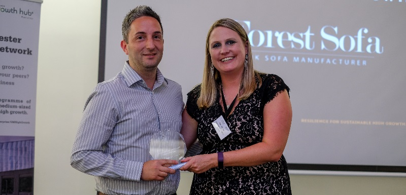 Ryan Mohieddin from Forest Sofa is presented with the Outstanding Achievement and Highest Growth Award