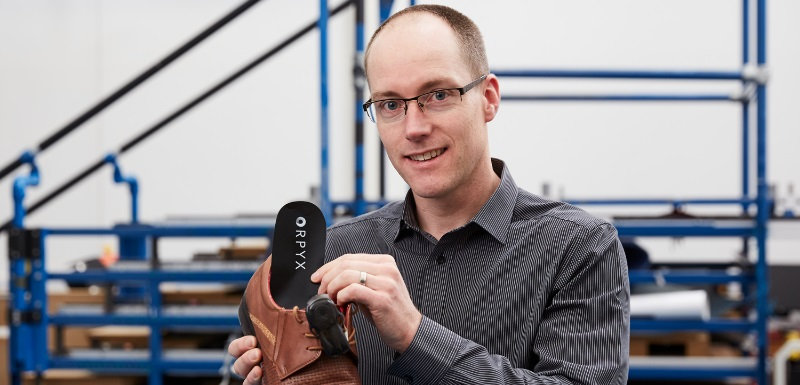 Professor Neil Reeves demonstrates Orpyx's SurroSense Rx® smart insole system