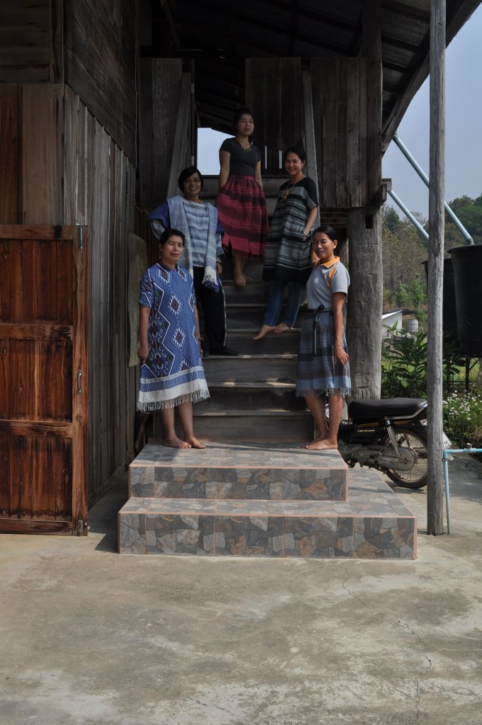 The Tai Lue Weavers at Ban DonChai Community Centre Nan province wearing garments made from their cloth